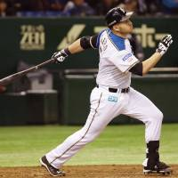 Keep it going: Brandon Laird hits a two-run single against the Lions during the fourth inning on Wednesday at Tokyo Dome. Nippon Ham won 6-1. | KYODO