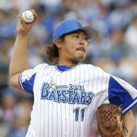 Game to remember: BayStars right-hander Shun Yamaguchi throws a pitch against the Dragons on Saturday at Yokohama Stadium. Yamaguchi went the distance in Yokohama's 5-2 triumph over Chunichi. | KYODO