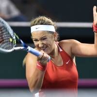 Methodical: Victoria Azarenka of Belarus hits a return against Japan's Misaki Doi during their singles match at the Fed Cup World Group II playoff on Saturday at Ariake Colosseum.   AFP-JIJI