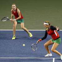 Working together: Victoria Azarenka (right) of Belarus returns a shot as Olga Govortsova looks on during their Fed Cup World Group II playoff double match against Japan's Shuko Aoyama and Ayumi Morita on Sunday at Ariake Colosseum. The Belarusian pair won the mach 6-3, 6-4. | REUTERS