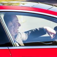 Prime Minister Shinzo Abe and Elon Musk, co-founder and chief executive officer of Tesla Motors Inc., share a laugh as they test drive a Tesla Model S car at Tesla headquarters in Palo Alto, California, on Thursday,  | BLOOMBERG