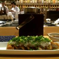 Chicken tempura is served in a crisp batter with a generous topping of grated daikon and chopped scallions. | ROBBIE SWINNERTON