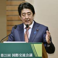 Prime Minister Shinzo Abe delivers a speech at a hotel in Tokyo on Thursday. | KYODO