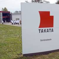 Journalists visit Takata Ignition Systems in Schoenebeck, Germany, in April 2014. | AP