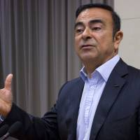 Nissan Motor Co. Chief Executive Carlos Ghosn speaks to reporters at the automaker's headquarters in Yokohama on Monday. | AP