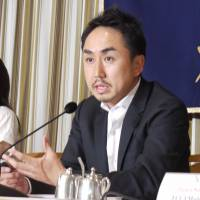 Line Corp. CEO Takeshi Idezawa fields questions at the Foreign Correspondents' Club of Japan on Wednesday in Tokyo. | YUZUHA OKA