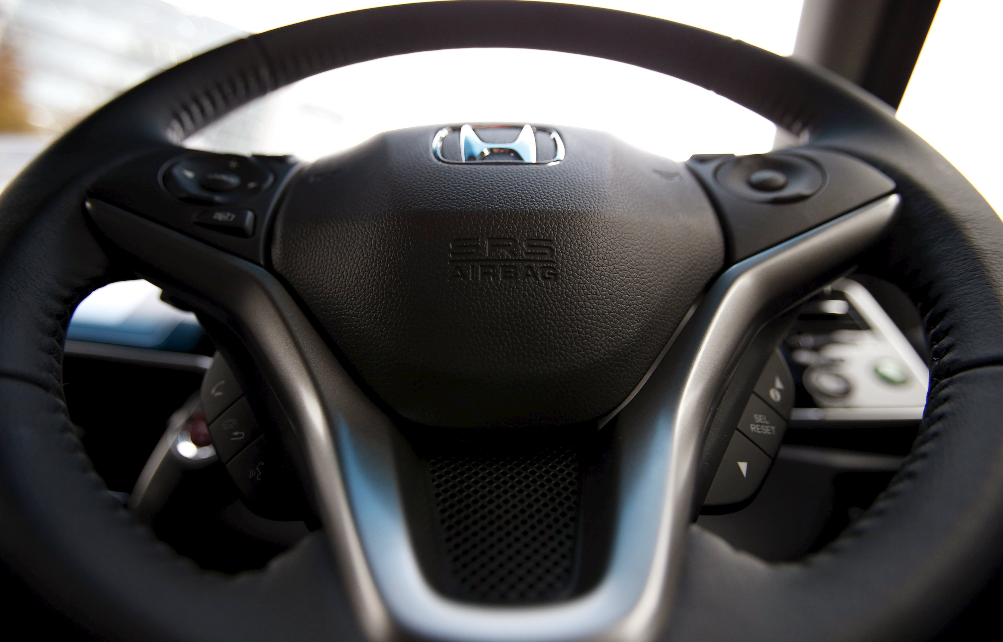 Air bag manufacturer Takata Corp and Japanese carmakers including Honda Motor Co are locked in the commercial equivalent of a bad marriage; not entirely happy in each other's company but unable to break apart and wary of potentially costly court battles.   | REUTERS