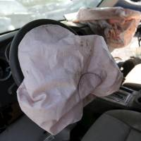 Deployed Takata air bags are seen in a 2007 Dodge Charger at a lot for recycled auto parts in Detroit on Wednesday. | REUTERS