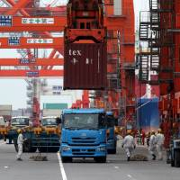 Japan slides back into trade deficit, erasing March surplus