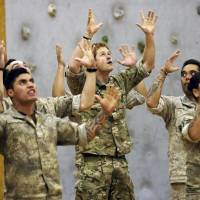 Britain's Prince Harry performs haka in New Zealand