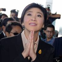 Ousted Thai PM Yingluck defends rice program at start of criminal trial