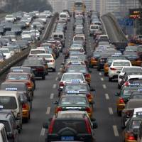 Chinese motorists have found that as they get richer they must share road space with others on the same path. | BLOOMBERG