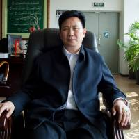 Sipu Enterprises Group Chief Executive Zhang Long poses at his office in Kunming, China, on Feb. 16. | REUTERS