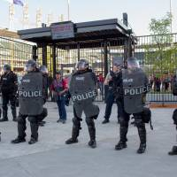 Cleveland agrees to supervised police force reforms after U.S. Justice Department probe of abuses