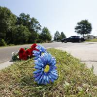 Man, woman charged with slaying two Mississippi cops during traffic stop; suspect at large after fleeing in cruiser