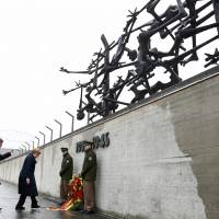 Merkel joins survivors, U.S. vets to mark liberation of Dachau