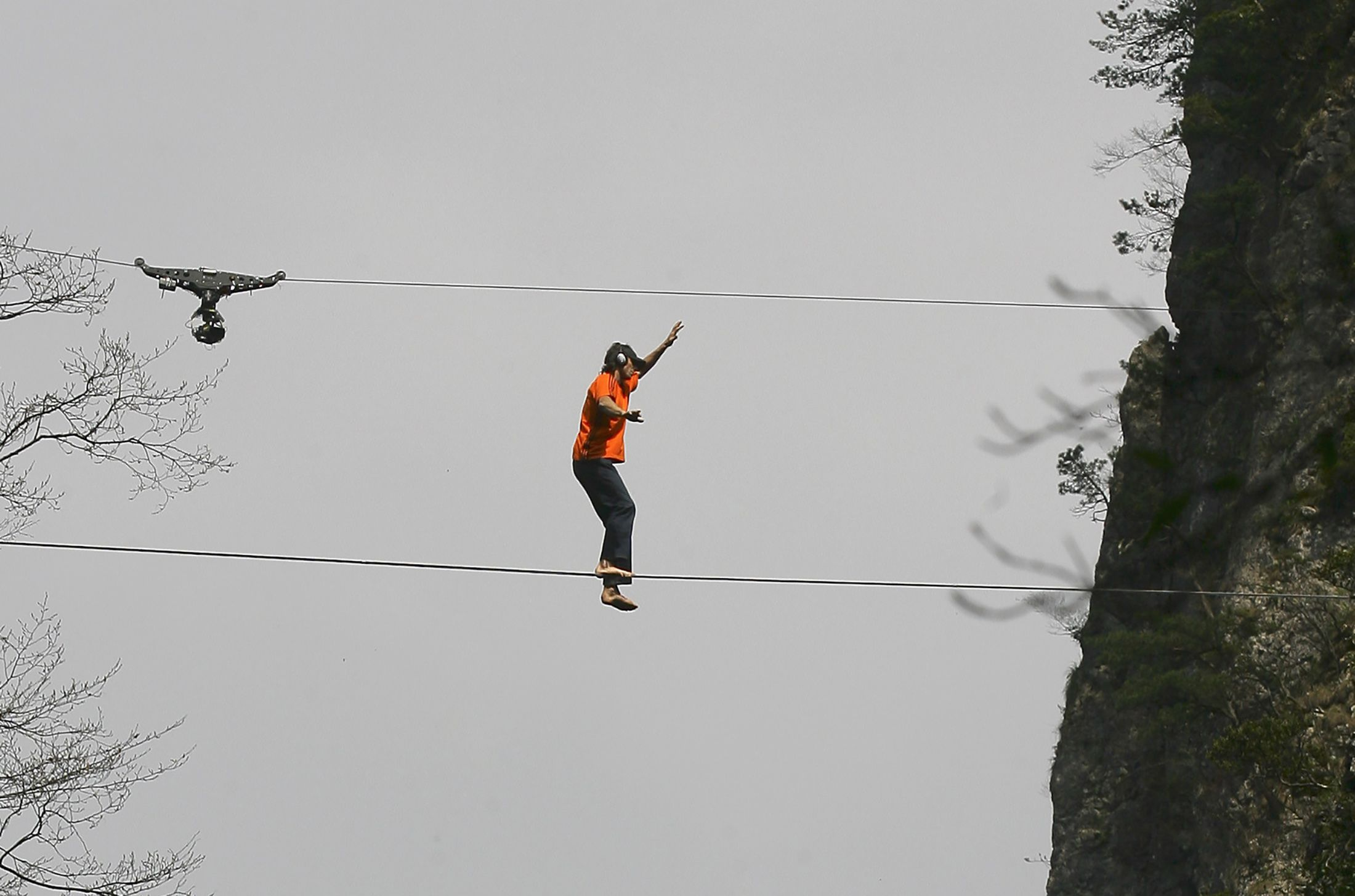 American climber Dean Potter walks barefooted on a rope connected between two mountain peaks in Enshi, Hubei province, China, in this file photo taken April 22, 2012. Potter and another man died while attempting parachute jumps from a 3,000-foot-high cliff in California's Yosemite National Park, officials said on Monday.   REUTERS