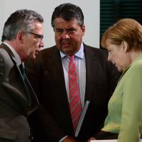 Spy claims expose cracks in Merkel's coalition