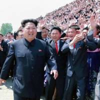 In this photo released on Sunday North Korean leader Kim Jong Un attends the second national meeting of 'Young Frontrunners in Noble Traits.' Western intelligence sources suspect Kim has ordered a new space entity to ready a test-launch of a long-range missile. | KCNA VIA KNS / AFP-JIJI