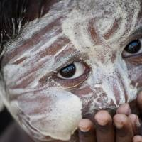 An ethnic Rohingya child looks out at a refugee camp outside the city of Sittwe in Myanmar's Rakhine state on Thursday.   AFP-JIJI
