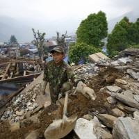 Nepal's sons return to rebuild quake-damaged family homes
