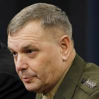 In this April 21, 2011, file photo, Gen. James Cartwright takes part in a news conference at the Pentagon. The former commander of U.S. nuclear forces said in an interview that 'de-alerting' nuclear arsenals would foil hackers by reducing the chance of launching a missile in response to a false warning of attack. He says this can be accomplished without eroding the weapons' deterrent value. | AP