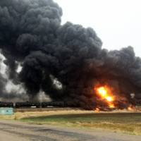 North Dakota town evacuated after oil train jumps tracks, turning into inferno