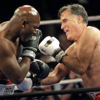 Romney lasts two rounds against Holyfield in charity boxing match