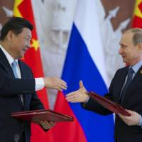 Xi, Putin agree to counter distortions of history, expand trade ties