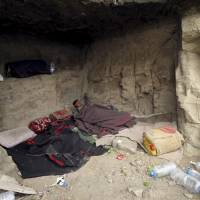 A youth sleeps in a cave after his home was destroyed during an air trike carried out by the Saudi-led coalition in Faj Attan village, Sanaa, on Thursday. The air trikes in this part of Sanaa have forced the village's population to flee their homes. | REUTERS