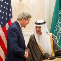 Newly appointed Saudi Minister of Foreign Affairs Adel al-Jubeir meets with U.S. Secretary of State John Kerry during a joint press conference at the Riyadh Air Base in the Saudi capital on Thusday. | POOL / ANDREW HARNIK / AFP-JIJI