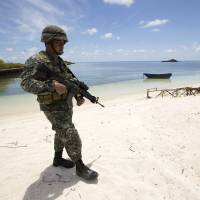 In Philippine bay, fear of China trumps fear of brothels