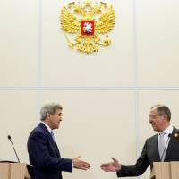 Kerry, Putin pledge to cooperate to bolster Ukraine peace accord