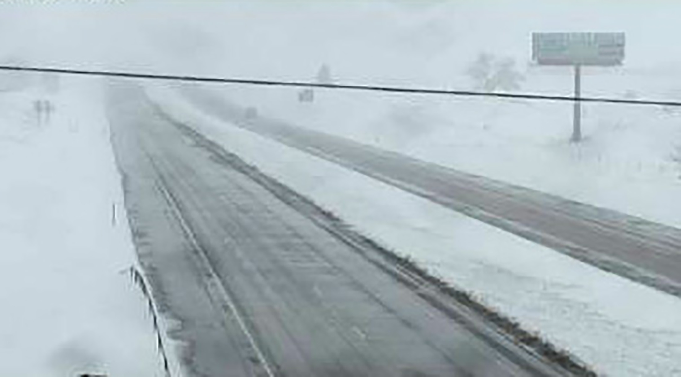 Snow covers the ground off Interstate 90 east of Sturgis, South Dakota, in this view from a highway camera taken Sunday.  Hail, snow, a tornado and a tropical storm made it a 'severe weather' Mother's Day in much of the center of the United States and on the Carolina coast on Sunday. | SOUTH DAKOTA DEPARTMENT OF TRANSPORTATION / HANDOUT  / REUTERS