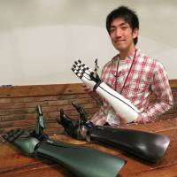 Exiii Inc. co-founder and CEO Genta Kondo shows off prototypes of the handiii robotic prosthetic arm. | KAZUAKI NAGATA