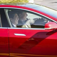 Prime Minister Shinzo Abe tries out a Tesla Model S P85D electric car Thursday with CEO Elon Musk in Palo Alto, California. | REUTERS