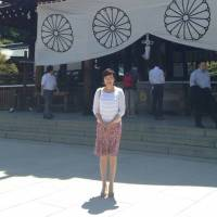 Akie Abe stands in front of what appears to be Tokyo's Yasukuni Shrine, in a screen shot of a photo posted on Facebook on Thursday.