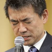 Osaka Mayor Toru Hashimoto faces the media at a news conference Sunday evening after Osaka voters rejected his plan to reorganize the city. | KYODO