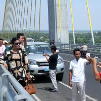 New Japan-funded bridge over Mekong River is a magnet for tourists in Cambodia
