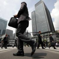 Morning commuters make their way to work in Tokyo on May 29, 2012.   BLOOMBERG