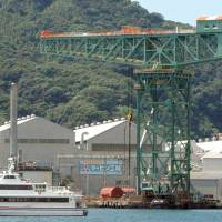 The giant cantilever crane at Mitsubishi Heavy Industries Ltd.'s Nagasaki shipyard is still in working condition 106 years after it was completed. | KYODO