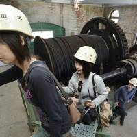 Visitors tour the disused Manda pit at the Miike Coal Mine on May 5, the day after news of the potential UNESCO listing was reported. | KYODO