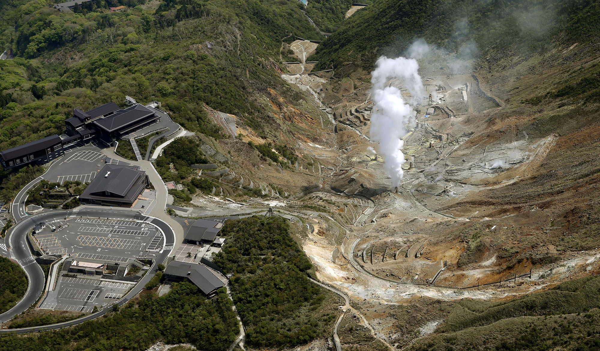 An aerial photo taken from Kyodo News helicoptor shows steam rising the ground in Hakone-machi, Kanagawa Prefecture. The Japan Meterological Agency said the number of volcanic earthquakes in Hakone on Tuesday reached 116, the highest ever recorded in one day.