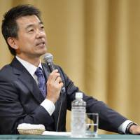 Osaka Mayor Toru Hashimoto speaks at a new conference in which he announced his retirement from politics in December. | KYODO