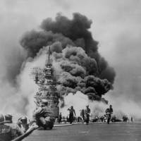 The USS Bunker Hill is hit by two kamikaze planes off Kyushu on May 11, 1945, during the Battle of Okinawa. | U.S. NATIONAL ARCHIVES