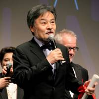 Director Kiyoshi Kurosawa speaks after being awarded the Best Director Prize for his film 'Journey to the Shore (Kishibe No Tabi)i,' which was competing in the Un Certain Regard section of the Cannes International Film Festival. | KYODO