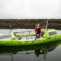Sonya Baumstein stands in her 23-foot (7.01 meter) carbon and kevlar solo rowboat in this handout picture courtesy of Andrew Cull in Port Townsend, Washington, on April 12. Baumstein will attempt a 6,000-mile (9,600 km) crossing of the Pacific Ocean — a feat no woman has ever accomplished solo, departing this month from Chiba Prefecture. | ANDREW CULL/HANDOUT VIA REUTERS
