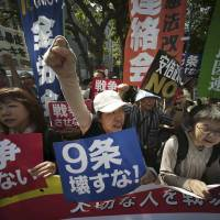 Hundreds of people rally outside Prime Minister Shinzo Abe's office in Tokyo on Thursday against a set of controversial bills that would expand Japan's defense role. | AP
