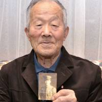 Sadao Suzuki, a former soldier in the Japanese Imperial Army, speaks of his war experience on Guadalcanal during an interview in Hokkaido. | KYODO