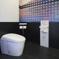 A toilet decked out with a scene of Mount Fuji is among the latest models on display at toilet showcase Gallery TOTO at Narita International Airport. | COURTESTY OF DAICI ANO